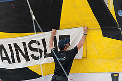 Ben Ainslie (GBR) put his name on the sail. Monsoon Cup 2009. Kuala Terengganu, Malaysia. 4 December 2009. Photo: Sander van der Borch / Subzero Images