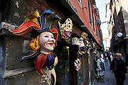 Jester mask and other Carnival maskes on display along street market, Venice, Italy..Subject photograph(s) are copyright Edward McCain. All rights are reserved except those specifically granted by Edward McCain in writing prior to publication...McCain Photography.211 S 4th Avenue.Tucson, AZ 85701-2103.(520) 623-1998.mobile: (520) 990-0999.fax: (520) 623-1190.http://www.mccainphoto.com.edward@mccainphoto.com.