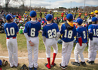 Laconia Rotary majors Eric Holder (10), Jack Higgins (6), Kurtis Jobin (23), Tim Ausevich (18), Jacob Hebert (3) and Kyle Harding (12) stand along the first base line during opening day ceremonies for Laconia Little League Saturday morning on Colby Field.  (Karen Bobotas/for the Laconia Daily Sun)