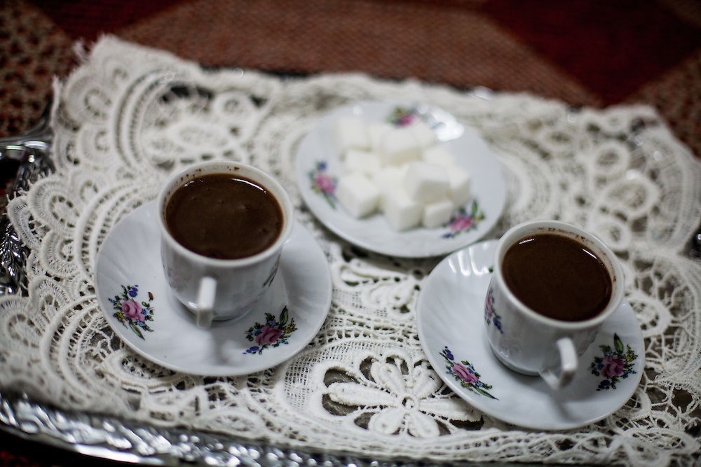 """Turkish coffee served in the house of Mehmet Kershi. Mr. Kershi fled the war  in Kosovo and lives from 1999 in the Konik Camp located in Podgorica. After the fire in 2012 when many inhabitants lost their former housing they received a container in which they live in since then. He has no valid papers such as Passport and Identity Card and is since his arrival in Montenegro unemployed. He partly corporates with the """"Crisis Council of the Association of Displaced Roma and Egyptians from Kosovo in Montenegro"""" and belongs to the Egyptians in the community."""