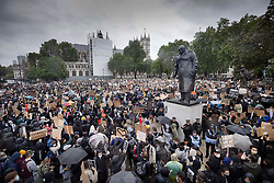 © Licensed to London News Pictures. 06/06/2020. London, UK. Protesters gather in Parliament Square, central London, during a Black Lives Matter demonstration over the killing of African American George Floyd. The death of George Floyd, who died after being restrained by a police officer In Minneapolis, Minnesota, caused widespread rioting and looting across the USA. Photo credit: Peter Macdiarmid/LNP
