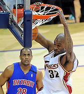 Joe Smith slam dunks the ball as Detroit's Arron Afflalo looks on at Quicken Loans Arena.