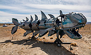 """A large metal fish sculpture at the junction of Rutas 40 and 23, the turn to El Chalten mountain resort in Santa Cruz Province, Argentina, Patagonia, South America. The village is settled on the riverside of Rio de las Vueltas, within Los Glaciares National Park near the base of Cerro Fitz Roy (3405 m or 11,171 ft elevation), at the edge of the Southern Patagonian Ice Field. The town is 220 km north of El Calafate. Chaltén comes from a Tehuelche word meaning """"smoking mountain"""", due to clouds that usually form over Monte Fitz Roy."""