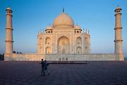 Tourists by Taj Mahal mausoleum eastern view, Agra, Uttar Pradesh, India