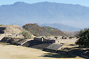 Mountains tower over the Zapotec ruins at Monte Albán, Oaxaca, Mexico.