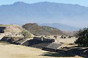 Mountains tower over the Zapotec ruins at Monte Albán, Oaxaca, Mexico.
