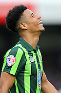 Lyle Taylor of AFC Wimbledon shows his delight as his goals secure a 1-2 win. Skybet football league two match, Wycombe Wanderers  v AFC Wimbledon at Adams Park  in High Wycombe, Buckinghamshire on Saturday 2nd April 2016.<br /> pic by John Patrick Fletcher, Andrew Orchard sports photography.