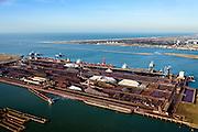 Nederland, Zuid-Holland, Rotterdam, 18-02-2015; Europoort met Calandkanaal in de voorgrond. Ertsoverslagbedrijf Europoort met bulkcarries aan de zeekade die worden gelost door grijperkranen. In de Dintelhaven duwbakken en de kolenterminal. Opslag van ijzererts, steenkolen en andere grondstoffen voor de staalindustrie. <br /> Europoort with terminals for dry bulk handling, ore and coal for German Steelmaking industry.<br /> luchtfoto (toeslag op standard tarieven);<br /> aerial photo (additional fee required);<br /> copyright foto/photo Siebe Swart