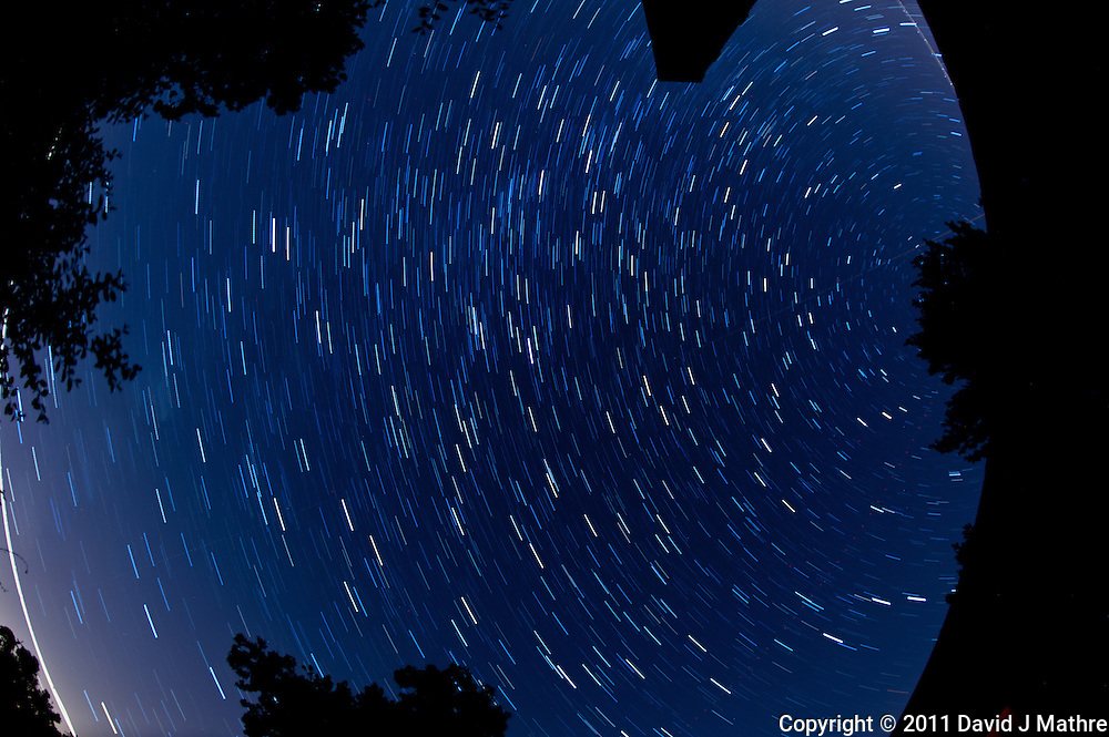 North View Star Trails. Summer Night in New Jersey. Image taken with a Nikon D3s and 16 mm f/2.8 mm Fisheye lens (ISO 400, 16 mm, f/4, 59 sec). Composite of 15 images combined using the Startrails program.