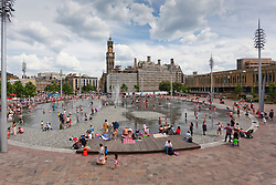 © Paul Thompson Licensed to London News Pictures. 26/07/2014. Bradford West Yorkshire. Crowds of people enjoying the fountains in Bradford's Centenary Square. Photo credit : Paul Thompson/LNP