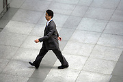overhead view of an Asian businessman walking Japan