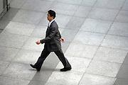 overhead view of an Asian businessman walking Japan