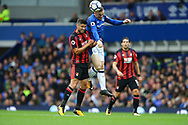 Wayne Rooney of Everton jumps above Andrew Surman of Bournemouth to head the ball. Premier league match, Everton vs Bournemouth at Goodison Park in Liverpool, Merseyside on Saturday 23rd September 2017.<br /> pic by Chris Stading, Andrew Orchard sports photography.