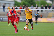 Aaron Collins of Newport county runs past Keith Lowe of York city (l). Skybet football league two match, Newport county v York city at Rodney Parade in Newport, South Wales on Saturday 5th Sept 2015.  pic by Andrew Orchard, Andrew Orchard sports photography.