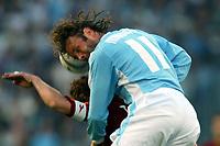 Roma 21/4/2004 Campionato Italiano Serie A <br />Lazio - Roma 1-1 <br />Sinisa Mihailovic (Lazio) and Francesco Totti (Roma) <br />Lazio and Roma are playing again after it was suspended on March 21, 2004, for security reasons.  <br />Foto Andrea Staccioli Graffiti