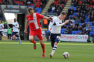 Bolton's opening scorer Joe Mason is challenged by Blackburn's Matthew Kilgallon. Skybet championship match, Bolton Wanderers v Blackburn Rovers at the Reebok Stadium in Bolton, England on Saturday 1st March 2014.<br /> pic by David Richards, Andrew Orchard sports photography.