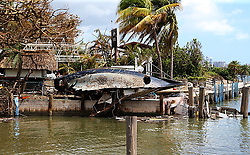 A hull of a destroyed sail boat lays at the seawall at Scottish Landing waterfront dining restaurant at Grove Key Marina in Miami, after Hurricane Irma passed over South Florida, on Tuesday, September 12, 2017. Photo by Pedro Portal/El Nuevo Herald/TNS/ABACAPRESS.COM