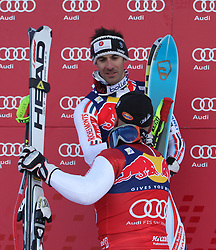 KITZBUHEL AUSTRIA. 22-01-2011. Didier Cuche (SUI) winner congratulates Adrien Theaux (FRA) 2nd at the presentation ceremony for the 71st Hahnenkamm downhill race part of  Audi FIS World Cup races in Kitzbuhel Austria.  Mandatory credit: Mitchell Gunn