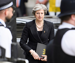 © Licensed to London News Pictures. 23/04/2018. London, UK.  British Prime Minister THERESA MAY arrives for a service held at St Martin In-The-Fields church in Westminster to mark the 25 anniversary of the death of Stephen Lawrence. 18 year-old Stephen Lawrence was killed in an unprovoked racial attack while he waited at a bus stop in Eltham, South East London in 1993. Photo credit: Ben Cawthra/LNP