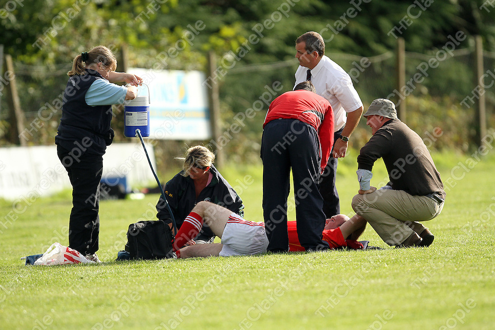 Smith O' Briens Pat Ahern receives treatment during their game against O' Callaghans Mills in Scariff on Saturday evening.<br /> Photograph by Yvonne Vaughan