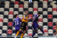 Newport County's Brandon Cooper (6) heads away under pressure from Tranmere Rover's Paul Lewis (22) and  Kaiyne Woolery (14) during the EFL Sky Bet League 2 match between Newport County and Tranmere Rovers at Rodney Parade, Newport, Wales on 17 October 2020.
