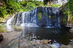 Upper Talololo Falls. This 30-foot waterfall in the Ugum River cascades into a deep pool framed by steep bluffs and level rock ledges is a main tourist attraction of Guam.