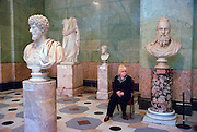 Saint Petersburg, Russia, June 2002..A Hermitage attendant and exhibits in the museum?s vast classical collection. The Hermitage, former home of the Tsars, is one of the world's great museums..