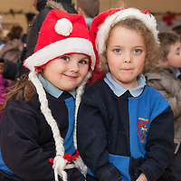 Junior Infants Gabrielle and Lucy watching the Art Competition ceremony at Scoil Chriost Rí on Thursday