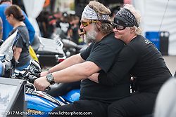 Jack and Caro Dlude of Montreal Canada check out a 2017 Harley-Davidson Electra Glide Ultra Limited Low at the Harley-Davidson display at the Daytona Speedway during Daytona Bike Week. Daytona Beach, FL. USA. Monday March 13, 2017. Photography ©2017 Michael Lichter.
