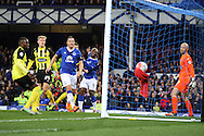 Arouna Kone of Everton (c)  heads the ball and scores his teams 1st goal Dagenham & Redbridge goalkeeper Mark Cousins looks on. The Emirates FA cup, 3rd round match, Everton v Dagenham & Redbridge at Goodison Park in Liverpool on Saturday 9th January 2016.<br /> pic by Chris Stading, Andrew Orchard sports photography.