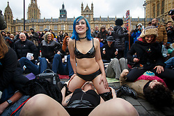 © Licensed to London News Pictures. 12/12/2014. LONDON, UK. Demonstrators taking part at a mass facesitting protest against the proposed restrictions on British producers of online porn, which bans actions such as spanking, facesitting, physical restraint and female ejaculation being filmed, outside Houses of Parliament in London on Friday, 12 December 2014. Photo credit : Tolga Akmen/LNP