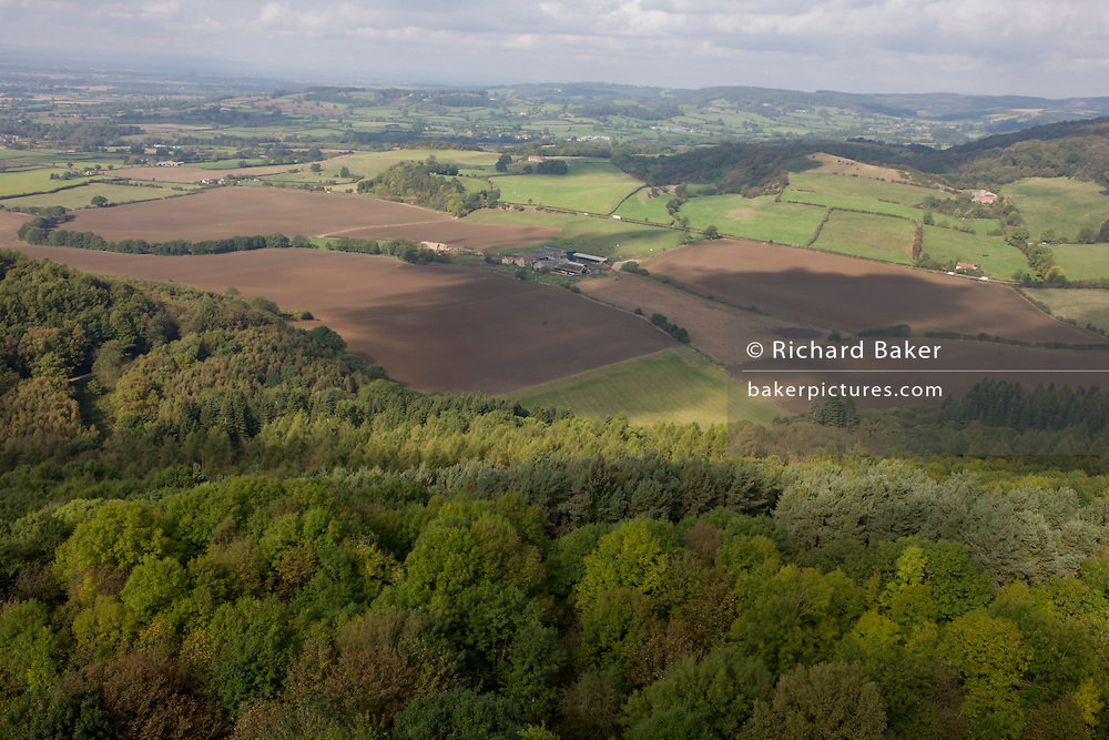 Aerial landscape looking from Sutton Bank to distant North Yorkshire fields below.