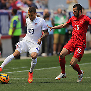 Fabian Johnson, (left), USA, in action against Oguzhan Ozyakup, Turkey, during the US Men's National Team Vs Turkey friendly match at Red Bull Arena.  The game was part of the USA teams three-game send-off series in preparation for the 2014 FIFA World Cup in Brazil. Red Bull Arena, Harrison, New Jersey. USA. 1st June 2014. Photo Tim Clayton