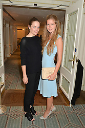 Left to right, BEANIE MAJOR and KATIE READMAN at a breakfast hosted by Halcyon Days at Fortnum & Mason, 181 Piccadilly, London on 8th July 2014.