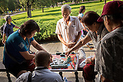 Chinese people play mahjong a traditional board game at the Temple of Heaven Park in Beijing, China