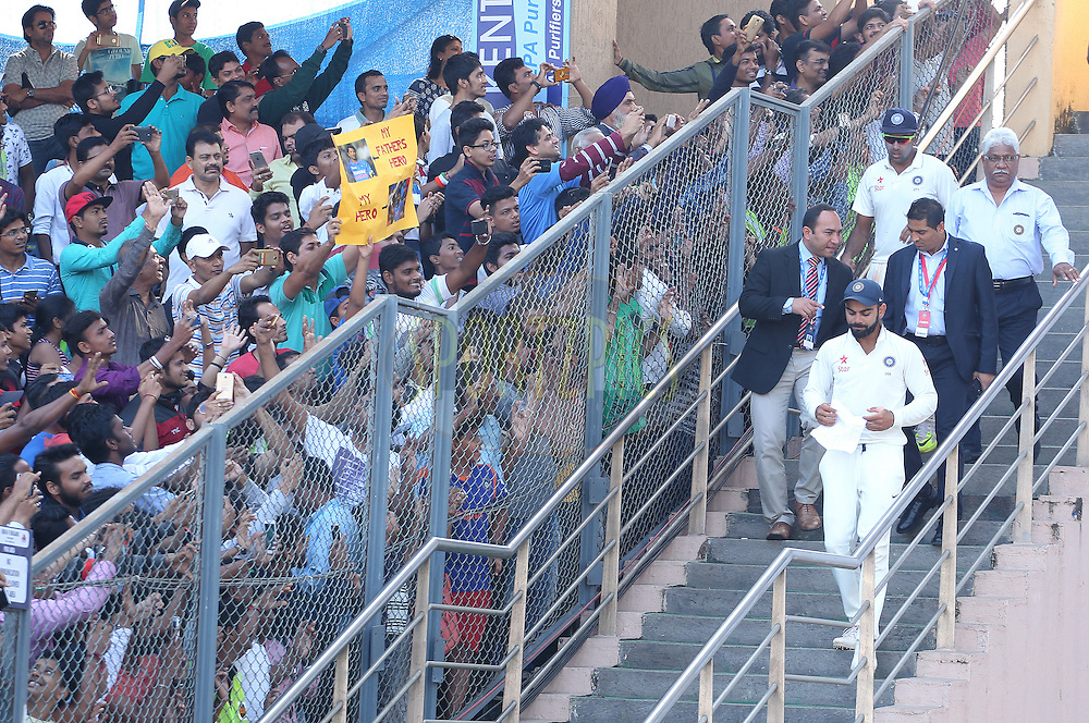 Virat Kohli Captain of India is cheered by fans after the match during day 5 of the fourth test match between India and England held at the Wankhede Stadium, Mumbai on the 12th December 2016.<br /> <br /> Photo by: Ron Gaunt/ BCCI/ SPORTZPICS