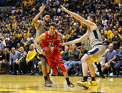 Feb 26, 2018; Morgantown, WV, USA; Texas Tech Red Raiders guard Davide Moretti (25) drives to the basket during the first half against the West Virginia Mountaineers at WVU Coliseum. Mandatory Credit: Ben Queen-USA TODAY Sports