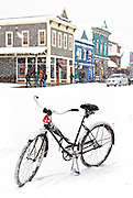 """SHOT 2/12/12 11:18:54 AM - A snow covered cruiser bike on Elk Avenue in Crested Butte, Co. Crested Butte is a Home Rule Municipality in Gunnison County, Colorado, United States. A former coal mining town now called """"the last great Colorado ski town"""", Crested Butte is a destination for skiing, mountain biking, and a variety of other outdoor activities. The population was 1,529 at the 2000 census. The Colorado General Assembly has designated Crested Butte the wildflower capital of Colorado. The primary winter activity in Crested Butte is skiing or snowboarding at nearby Crested Butte Mountain Resort in Mount Crested Butte, Colorado. Backcountry skiing in the surrounding mountains is some of the best in Colorado. The mountain, Crested Butte, rises to 12,162 feet (3,700 m) above sea level..(Photo by Marc Piscotty / © 2012)"""