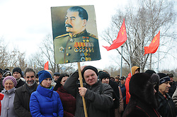 March 23, 2019 - Tambov, Tambov region, Russia - March 23, 2019. The Communist party of Russia is holding an all-Russian mass social and political action under the slogan '' we will Protect the social and economic rights of citizens!''. Rallies are held in many cities of Russia. In Tambov meeting took place in '' Rasskazovsky square''. In the picture- In the picture-a meeting of Communists in Tambov (Russia). In the center-a man with a portrait of Joseph Stalin (Credit Image: © Demian Stringer/ZUMA Wire)