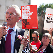 Lord Fowler, Conservative speaks to the celebrating crowd. The Same Sex Marriage bill had been passed in the House of Lords. London Gay Chorus and supporters of the bill celebrate outside the House of Lords. The campaign for the bill has lasted decades. Summary of the Marriage (Same Sex Couples) Bill 2012-13 to 2013-14<br /> A Bill to make provision for the marriage of same sex couples in England and Wales, about gender change by married persons and civil partners, about consular functions in relation to marriage, for the marriage of armed forces personnel overseas, and for connected purposes.