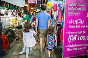 01 APRIL 2013 - BANGKOK, THAILAND:  Tim Hupe and his daughters, Elijah and Arielle, walk through a Bangkok market.   PHOTO BY JACK KURTZ