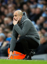 Manchester City manager Pep Guardiola reacts on the touchline during the Premier League match at the Etihad Stadium, Manchester.