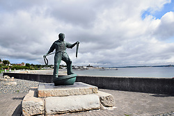 Statue by Tom Leaper to commemorate Cornish fishermen who have lost their lives at sea, Newlyn, Cornwall UK