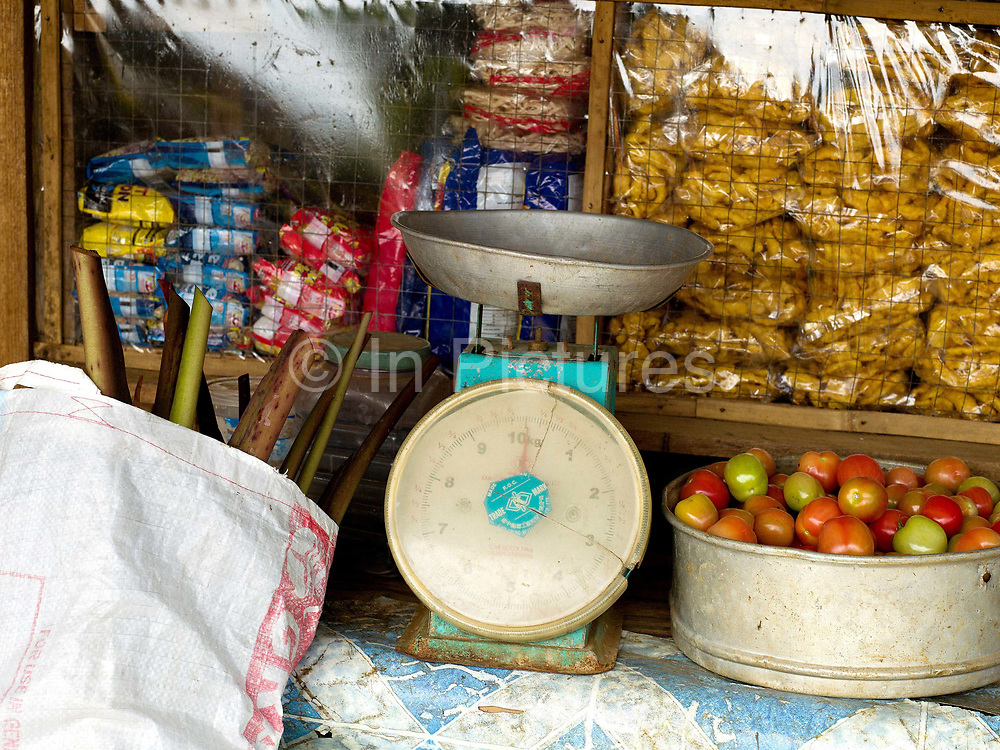 72 year old Lilia Malinao's small vegetable shop outside her home in Sitio Matinao, Alamada, Cotabato province, Mindanao Island, The Philippines. Lilia is also President of 'Women's Rural Improvement Club' and has been involved in Oxfam's BINDS project for 1 year and 8 months. In the Philippines climate change is contributing to an increase in the frequency and intensity of typhoons as well as a general rise in temperatures and rain leading to an increase in droughts, flash floods and landslides. This is having a huge impact on smallholder farmers who depend on one cash crop leaving them vulnerable to any changes in weather patterns. If their crops fail they are left with no other source of income for that year. In central Mindanao Oxfam is working with local partners and governments to increase awareness of climate change in poor communities and reduce the risks it creates to vulnerable farmers by supporting them in crop diversification.