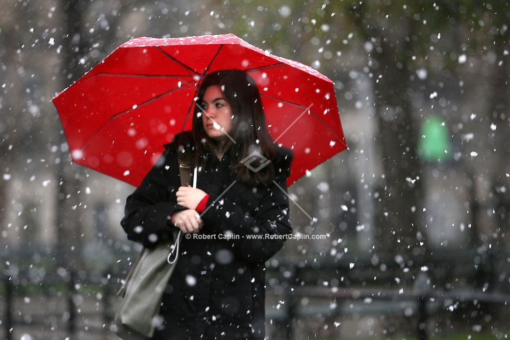 Amidst the heavy snow, NYU student Leora Sarna walks through Washington Square park on the New York University campus in Manhattan, Wed. April 5, 2006. Photo by Robert Caplin For The New York Times..