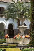 Fountain in the garden courtyard of the Interior del Convento de San Francisco - Quito, Ecuador, South America