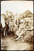 Western people posing with rural Moroccan Berber children 1930s
