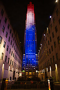 New York, NY - 3 November 2020. New York City anticipates presidential election results as polls in some states close. Rockefeller Center, which was the scene of crowds listening to election announcements in 2016, is closed to all, while the building itself is lit in red, white, and blue.