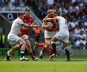 Wales' James King is held by Englands George Ford during the The Old Mutual Wealth Cup match England -V- Wales at Twickenham Stadium, London, Greater London, England on Sunday, May 29, 2016. (Steve Flynn/Image of Sport)