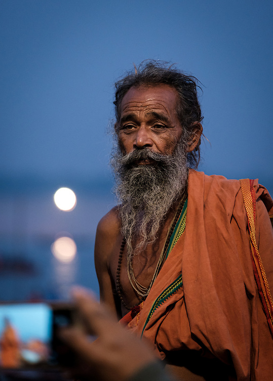 Varanasi, INDIA - CIRCA NOVEMBER 2018: Priest during Dev Deepawali In Varanasi. Varanasi is the spiritual capital of India, the holiest of the seven sacred cities and with that many rituals and offerings are performed daily by priests and hindus.